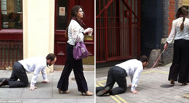 امرأة تقود رجل باحدى شوارع لندن وكأنه كلبها الخاص